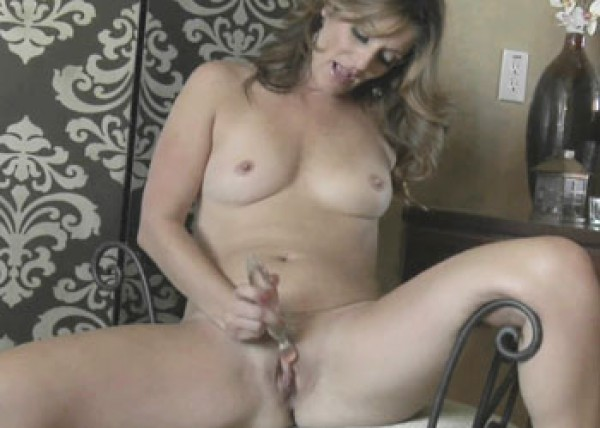 Alicia Silver plays with her glass dildo