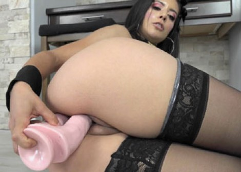 Jynx Maze stuffs herself with a big toy